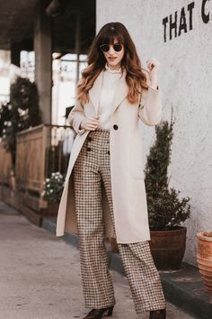 Long tan wool coat with lace top and plaid trousers and croc boots. #neutralfalloutfit #fallfashion #fallstreetstyle #autumnoutfits