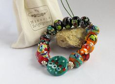 Items similar to Four colour glass bracelet on Etsy Flower Shape, Abstract Pattern, Arts And Crafts, Shapes, Create, Glass, Etsy, Color, Drinkware