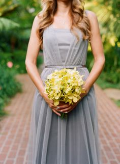 love the gray bridesmaid dress and yellow orchid bouquet combo