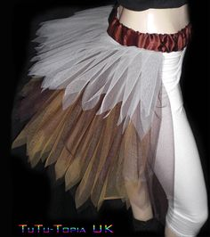 this bustle looks more feathered... but I'm not sure I like it better than just flat tulle...