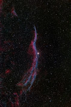 ~~Cirrus West Veil Nebula  The Veil Nebula (Cygnus Loop, Cirrus Nebula) is a cloud of heated and ionized gas and dust in the constellation Cygnus. It constitutes the visible portions of the Cygnus Loop, a large but relatively faint supernova remnant. The source supernova exploded some 5,000 to 8,000 years ago, and the remnants have since expanded to cover an area roughly 3 degrees in diameter (about 6 times the diameter, or 36 times the area, of the full moon)    by Johannes Schedler~~
