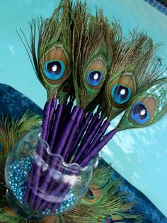 Peacock feather pen party favors