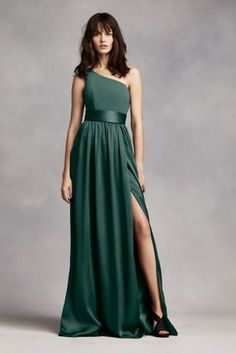 Timeless and chic, thisfloor sweepingdress draws a romantic appeal!  One shoulder dress with crepe bodice features a flattering trapunto satin sash at the waist.  Longsoft matte charmeuse skirt with side slit.  Sizes 0-26.  Fully lined. Back zip. Imported. Dry clean only.