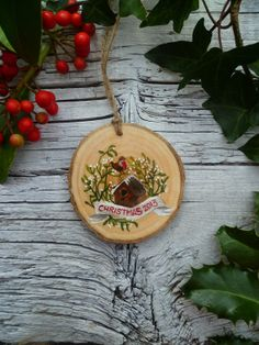 Wooden slab-Vintage Inspired Wooden Christmas Ornament: Christmas Banner with Birdhouse $29.47 CAD.