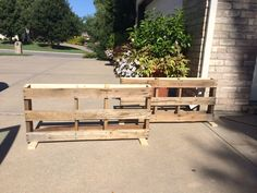 Pallets cut in half with feet added, ready to be painted and filled