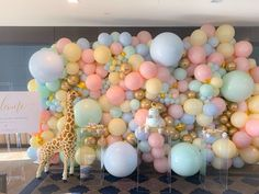 Our client requested an elegant, yet whimsical, gender neutral Baby Shower and we delivered! Featuring a organic balloon wall, acrylic pillars, an adorable cake and a giant stuffed giraffe. Gender Reveal Balloons, Gender Reveal Party Decorations, Balloon Decorations, Balloon Backdrop, Balloon Garland, Balloon Columns, Graduation Party Decor, Birthday Party Decorations, Baloon Wall
