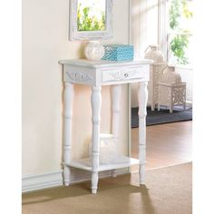 Shaped legs and shell-design trim add distinction to this shabby chic decorative accent table. A generous drawer and a bottom shelf provide plentiful storage. Accent Table Decor, White Accent Table, Side Table Decor, Wooden Side Table, White Side Tables, Shabby Chic Accent Table, Accent Tables, Accent Furniture, Table Furniture
