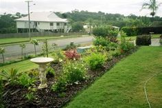 "Garden with Household Sewage Treatment systems - Ozzi Kleen - Testimonial: ""Great! No smell, No soggy trenches, good irrigation for my gardens"". Grant Lucas, Peachester QLD"
