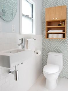 Are you missing a medicine cabinet and needing a place to store all of your bathroom amenities? Consider adding a cabinet above the toilet or on any free wall for the perfect accessory to contain and conceal.