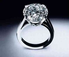 ❦ The De Beers Platinum Diamond Ring boasts a nine-carat gem placed on a perfectly polished platinum ring.