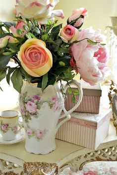 Lovely... I keep freshly cut roses in a vintage vase in almost all the rooms in my cottage- Oh the smell is divine!