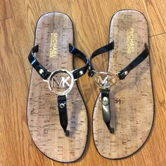 MK sandals Authentic MK sandals. I wore these twice last year. A little of the writing came off the inside of the left shoe. Otherwise, these are in perfect condition. MICHAEL Michael Kors Shoes Sandals