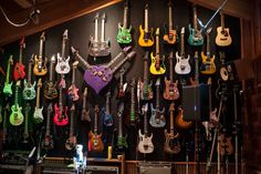 Steve Vai's guitars ~ The purple heart shaped one with three arms intrigues . did he have 3 hands, one for each guitar arm? Guitar Wall, Music Guitar, Cool Guitar, Playing Guitar, Guitar Room, Steve Vai, Unique Guitars, Custom Guitars, Guitar Storage