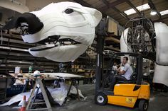 polar bear puppet walks to protect the arctic for greenpeace