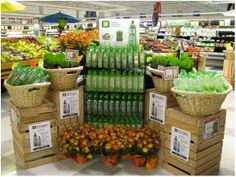 Beautiful Alo display cross-merchandised with produce!