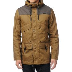 Get military style with a casual fashionable look with the Firing Line parka from Empyre. This long fit guys jacket is an allover khaki color with a contrasting dark brown front and back yoke, attached drawstring hood, full lining, and a zipper and button front closure. Four front pockets with button or clip closures, a cinch-able bottom hem, and custom Empyre hardware makes the Firing Line military jacket a Fall must have for any guy that wants to be comfy, look cool, and stand out.