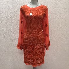 Swimsuit cover up or sheer tunic, made in India NWOT What a beautiful tunic/swim cover up this is! It recently traveled straight from the artist in India. These coral/red colors are even more boho beautiful in person!  Crocheted detail, hand embroidery and sequins throughout. This lovely will fit a standard large and has a straight fi through the body. This is the ONLY ONE I HAVE in this style and color. It has two slits, one on each side. It also is worn perfectly as a swimsuit cover up. It…