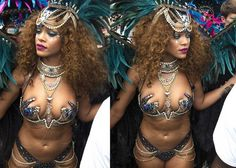 Rihanna uncovers all, parades around in tiny, sexy costume at Barbados festival ( Photos)