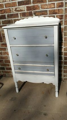 Dainty  refinished white distressed  dresser with gray drawers and glass knobs.