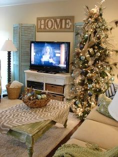 cobblestone farms watching a movie by the tree tv stand christmas decor