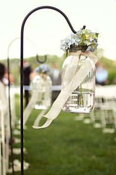Mason jars on the aisles with ribbon