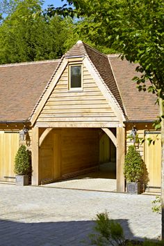 The garage with one bedroom flat above. Design and construction of a wide range of bespoke country building are available from Oakwrights Country Buildings, Oakwrights little brother.