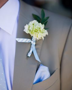 A small grouping of hydrangeas was meant to make this boutonniere resemble a cloud