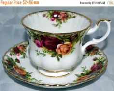Beautiful Royal Albert set - footed tea cup and saucer in uncommon Autumn Roses pattern. Wonderful Fall soft colors - purple, pink, blue, grey.