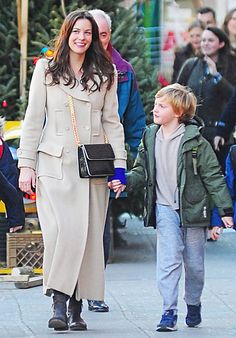 Liv Tyler and son Milo passed a Christmas tree vendor when they stepped out in Manhattan's West Village on Dec. 14.