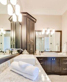 Custom cabinetry allows perfect organization in this master bathroom. The Rangemoss #1211. http://www.dongardner.com/house-plan/1211/the-rangemoss. #Master #Bathroom #Organization