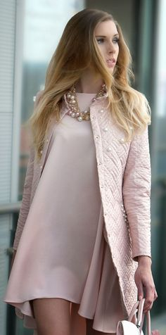 Dusty rose chic style: quilted coat, dress, bag, pearls. …