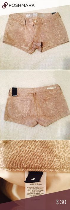 Express Beige Snakeskin Shorts Cute beige size 4 Snakeskin shorts from Express.  These genes are brand new and have never been worn.  My sister bought them for herself but never had to chance to wear them as she gained weight after being pregnant. | Instagram: @Lina.Chen Express Shorts Jean Shorts