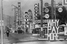 Las Vegas Strip, Nov. 1963 by Thomas Hoepker. This row of motels – Tahiti, Ramada, Sunrise, Royal Vegas, Jamaica, Del Rey, Monie Marie – was south of Harmon Ave, all demolished in the late 1990s. Tally Ho, in the distance, is now Planet Hollywood.
