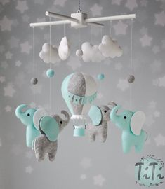 Personalized Elephants and balloon baby mobile in custom colors. This item will contains 1 handmade felt hot air balloon ,4 handmade felt elephants, 4 handmade felt clouds, 5 handmade wool felt balls and wood mobile in white color. The balloon is decorated with pompons, bunting flags and and little Baby Mobile Felt, Boy Mobile, Felt Baby, Elephant Balloon, Elephant Elephant, Ballon, Air Balloon, Baby Boy Cribs, Kids Lamps