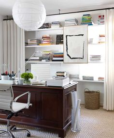 Where To Hang Curtain Rods - Other Uses | Apartment Therapy  Conceal Clutter  Hanging curtains across bookshelves is a classic decorator move. The layered look adds warmth and eliminates visual clutter. After all, neat and tidy bookshelves aren't always a reality, and it's nice to have the freedom to cover them up when things get out of hand. Designer Lindsay Bond covered up her office shelves, seen in House Beautiful.