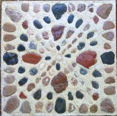 Mozaiek tuintegel met natuurstenen in cement.