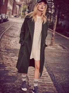 Maxi Swing Trench | Oversized cloak coat with deep pockets and a belted waist. Fully lined.