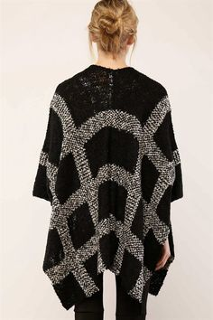 This poncho-inspired dolman cardigan is a timeless knit with an extraordinary potential to change your outfit into a superb one. Turn the streets into your own runway in this chic piece featuring a op