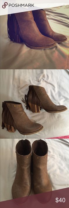 Fringe boots EUC brown boots with leather fringe. 3 of the fringes are a little short but not noticeable at all. These are show stoppers , I got endless compliments from everyone every where I went . Only reason I'm selling is bc my feet grew from pregnancy:( Shoes Ankle Boots & Booties
