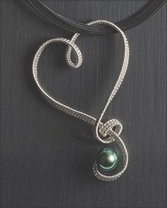 [Ganoksin] Textile Techniques in Jewelry Making. This is a beautiful heart pendant.  So me!!!! Love this.....