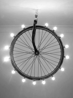 upcycled light- hanging bicycle wheel with front forks