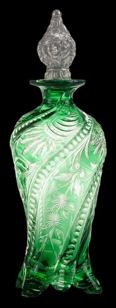 """Rare Stevens & Williams Emerald Cut on Engraved to Colorless Crystal Perfume Bottle. English, circa graceful form, four feet, swirled """"ropes"""" with stylized engraved flowers and geometric cutting, fine sterling repoussé stopper depicting Medusa with s Crystal Perfume Bottles, Antique Perfume Bottles, Vintage Bottles, Crystal Decanter, Crystal Glassware, Glass Crystal, Bottle Vase, Bottles And Jars, Glass Bottles"""