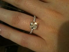 delicate cushion cut engagement ring. Thin  band, no halo (m'fave)