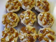 These cup cakes are prepared with peanut butter for a tasty kick and topped with a caramel frosting that can't be beat. The Cracker Jacks bring it all together.