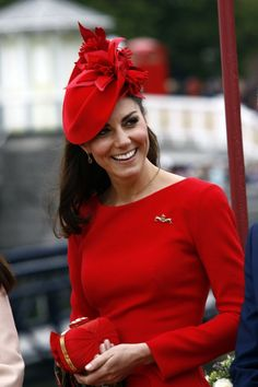 gorgeous red hat with flowers worn by Kate the Duchess of Cambridge smiles during the Thames Diamond Jubilee Pagent