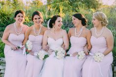 Beautiful bridal party photo ideas with bridesmaids. Light pink bridesmaid dresses