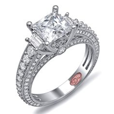 Designer Engagement Rings from DemarcoJewelry.com Available in White or Yellow Gold 18KT and Platinum. 1.18 CTWCapture her grace and endless beauty with this confident yet elegant design. We have also incorporated a unique pink diamond with every single one of our rings, symbolizing that hidden, unspoken emotion and feeling one carries in their heart about their significant other.  This is not just another ring, this is a heirloom piece of jewelry.  Demarco Bridal Engagement Ring.