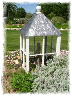 Make repurposed windows into a cute garden cupola.
