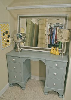 repurposed old desk turned into vanity... another fabulous Goodwill find! LOVE the grey and yellow together!