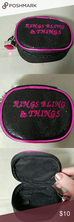 """RINGS, BLING & THINGS Jewelry & Trinkets Box Brand: Jasmine La Belle  Item: *Black & Hot Pink Zippered Glitter Case *Keep Your Jewelry, Bling, Change, Keepsakes, etc. *Silver Plastic Ring with Pink Heart Jewelry *Opens to a Lip Gloss -Never Used ...just figured it was there tonight and I've had this for like 3 years!  Color: Black, Hot Pink  Size: 3.5""""w x 2""""h x 3""""d  Condition: Very Good Pre-Loved Condition Jasmine La Belle Jewelry"""